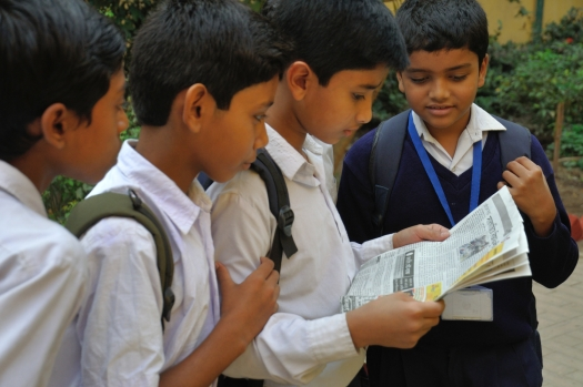 Kids reading newspapers